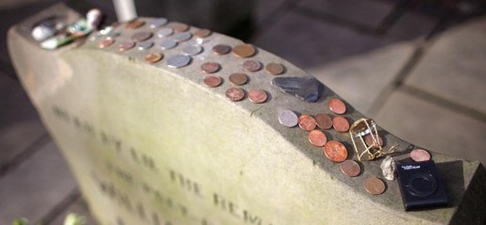 What Do The Coins Left On Military Tombstones Mean