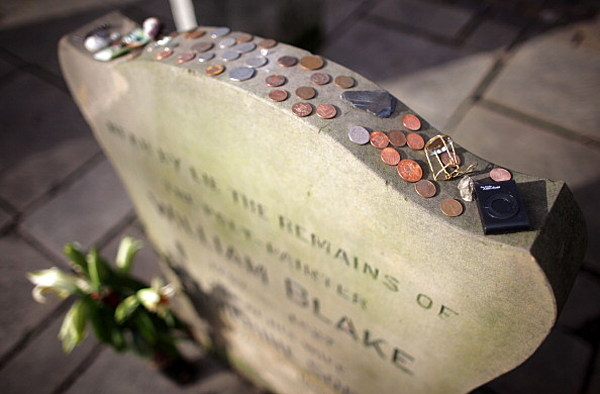coins on soldiers headstones