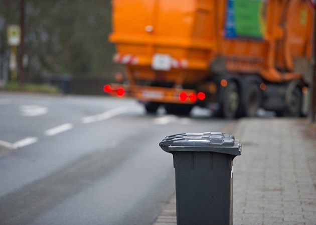 garbage can and garbage truck - istock