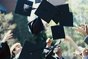 Students throwing their graduation hats in the air during a graduation ceremony