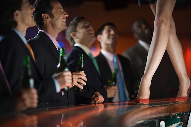 Businessmen at a Strip Club